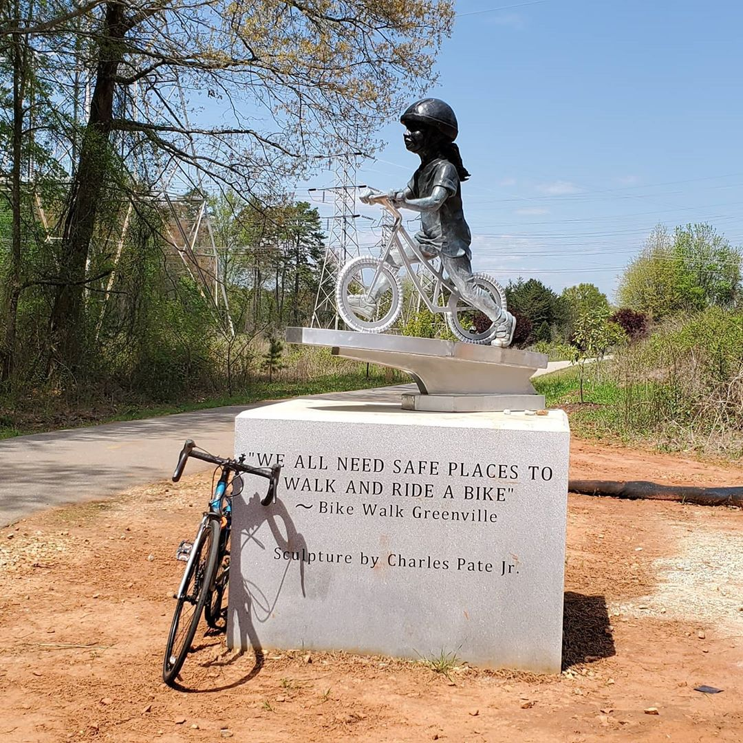 statue: a little girl rides a bicycle